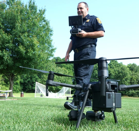 Lt. Paul Nicholas walks near the Farmington Hills Police Department's Matrice 210 drone. The drone comes with a heat signature camera. The officers operating the drone must be certified by the FAA and only use the technology within certain altitude limits.