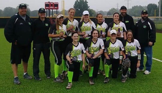 The Livonia Wild 15U Rons team poses with their trophies.