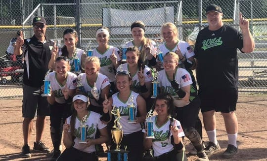 The Livonia Wild 16U Michels team poses with their trophies.