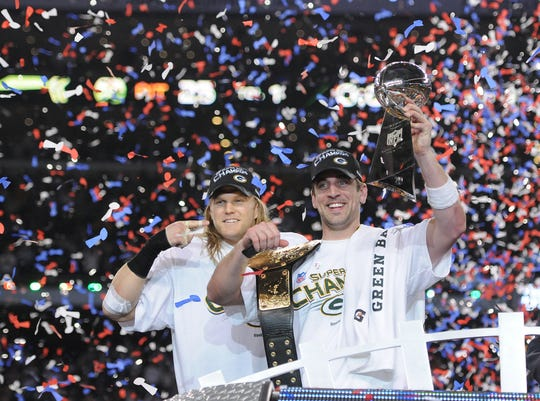 Green Bay linebacker Clay Matthews, left, points to Super Bowl MVP Aaron Rodgers after giving him a championship belt after the win against the Pittsburgh Steelers during Super Bowl XLV at Cowboys Stadium in Arlington, Texas on Feb. 6, 2011.