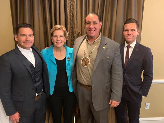 Tribal Council Member Anthony W. Purnel, Tribal Chairman Jeff L. Grubbe and Tribal Council Member Reid D. Milanovich meet with presidential candidate Elizabeth Warren Wednesday morning, July 31, 2019, after the prior night's Democratic Presidential debate.
