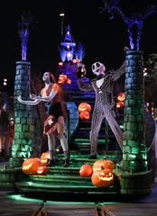 "The guest-favorite ""Frightfully Fun Parade"" delights guests at Disney California Adventure Park during the all-new separate-ticket Oogie Boogie Bash – A Disney Halloween Party on 20 select nights from Sept. 17-Oct. 31, 2019. The Headless Horseman of Sleepy Hollow heralds the arrival of Mickey Mouse and Minnie Mouse who lead the cavalcade of characters, including many mischievous Disney villains. New this year, the ever-curious and whimsical Cheshire Cat from ""Alice in Wonderland"" joins the parade, mischievously smiling at all the magical mayhem. (Scott Brinegar/Disneyland Resort)"