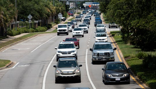 Traffic backs up on U.S. 98 in Gulf Breeze on Wednesday. With upcoming changes to traffic on the new Pensacola Bay Bridge and the start of school, some officials and residents are worried about an increase in congestion.