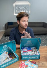 CEO Kyle Roarke talks about what typically comes in boxes from Snack Crate in downtown Pensacola on Wednesday, July 31, 2019.