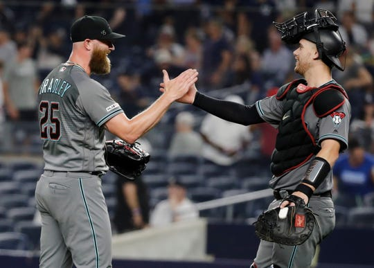 Arizona Diamondbacks relief pitcher Archie Bradley, left, celebrates with catcher Carson Kelly after the team's 4-2 win in a baseball game against the New York Yankees on Tuesday, July 30, 2019, in New York.