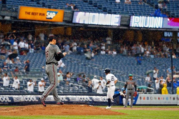 Jul 31, 2019; Bronx, NY, USA; Arizona Diamondbacks pitcher Yoshihisa Hirano (66) reacts after giving up a two run home run to New York Yankees catcher Austin Romine (28) during the seventh inning at Yankee Stadium. Mandatory Credit: Adam Hunger-USA TODAY Sports