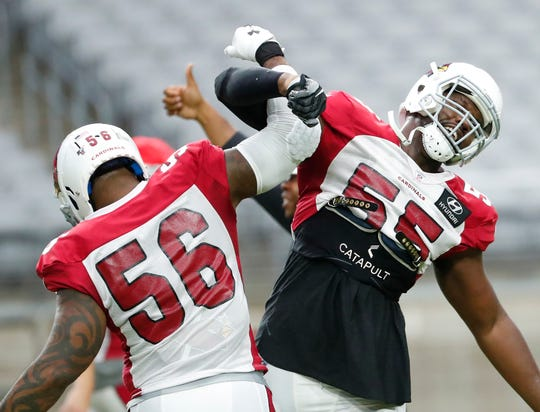 Arizona Cardinals linebackers Terrell Suggs (56) and Chandler Jones (55) celebrate during training camp at State Farm Stadium July 31, 2019.