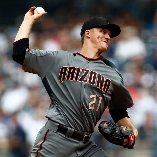 Zack Greinke allowed two runs in five innings against the Yankees before being dealt to the Astros.
