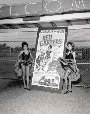 "The Rodeo Drive-In in Phoenix features the movie ""Red Garters"" in 1955."