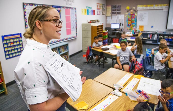 Basha Elementary School first-grade teacher Arianna Mehl works with her class at school in Chandler, Wednesday, July 31, 2019.