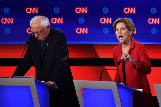 Sens. Bernie Sanders and Elizabeth Warren participate in the Democratic presidential candidate debate on Tuesday in Detroit.