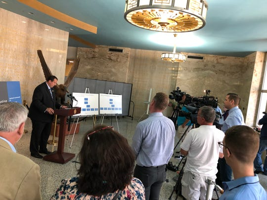 A throng of cameras and reporters gathers for a press conference with state representative Seth Grove at the podium in the Lebanon City Municipal Building on Tuesday.
