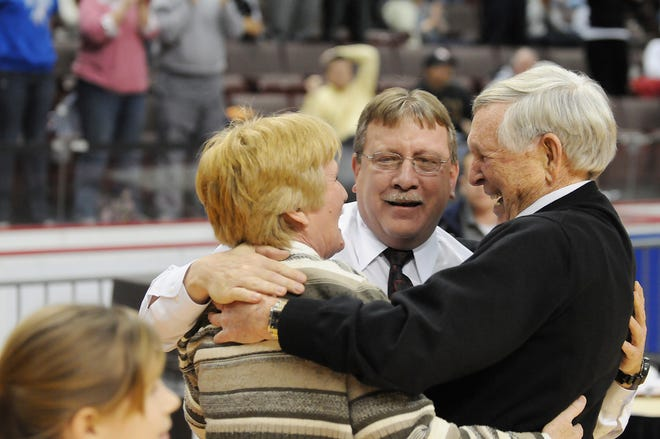 Lebanon Catholic's head coach Patti Hower, assistant coach Mike Mohl, center, and assistant coach Ed Werth celebrate after the District 3 single A championship. Lebanon Catholic defeated Steel-High 84-78 at the Giant Center on March 1, 2012. Werth passed away Saturday, July 27, 2019 at the age of 90.