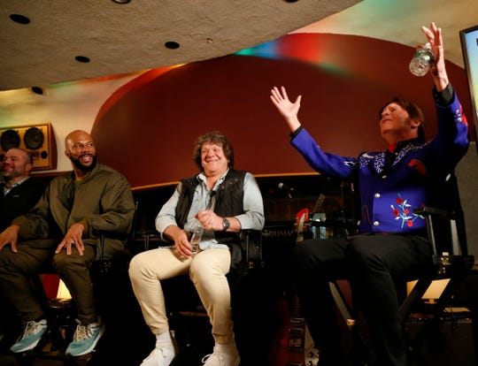 From left, Common, Woodstock promoter Michael Lang, and John Fogerty sit at a March 19 event announcing the lineup for the planned Woodstock 50 event, which was ultimately cancelled.
