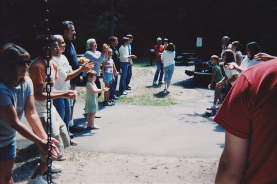 Members of the Tarner Family playing egg toss several years ago, always a favorite and a lot of fun.