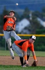 Stoverstown shortstop Joe Capobianco makes the throw to first base over teammate Buzz Schuchart, Tuesday, July 30, 2019. John A. Pavoncello photo