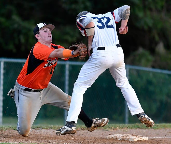Stoverstown third baseman Buzz Schuchart makes the tag on Dillsburg's Joey Deluca last July in Central League baseball action. The 2020 Central League season was supposed to start on Saturday. The season, however, has been put on hold by the COVID-19 pandemic. John A. Pavoncello photo
