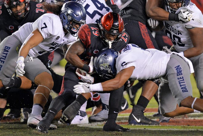 Nevada linebacker Gabe Sewell (7) is one of a number of Wolf Pack players to appear on the initial watch lists for college football's national awards.
