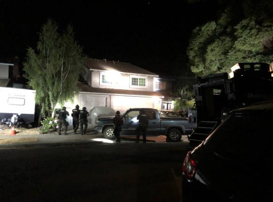 Police approach the Gilroy home of Santino William Legan, who was shot and killed by police shortly after opening fire at the Gilroy Garlic Festival July 28, 2019. The nearby Salinas Police Department's SWAT team responded to a call for assistance from Gilroy police. They assisted in securing several locations related to the case.
