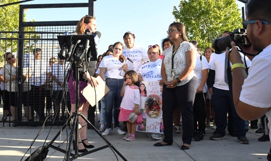 The Salazar family stands in front of cameras as representatives from the ACE Empower Charter School speak on their behalf to media outlets. July 30, 2019.