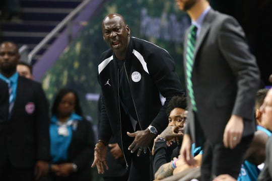 Dec 7, 2018; Charlotte, NC, USA; Charlotte Hornets team owner Michael Jordan yells at an official in the second half against the Denver Nuggets at Spectrum Center. Mandatory Credit: Jeremy Brevard-USA TODAY Sports