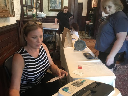 Cindy Wilkinson of Estate Pros checks out a customer at a recent estate sale at the Logan Mansion in downtown Shreveport.