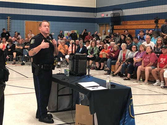 Lt. Terry Matia speaks to an estimated crowd of 350 at the Kenny Anderson Community Center Tuesday night where a town hall meeting was held to address the recent string of shootings in eastern Sioux Falls.