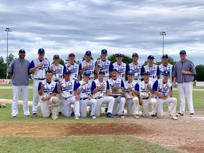 Renner Post 307 poses with their state championship plaque after defeating Rapid City Post 22 in the American Legion baseball state championship at Cadwell Park in Mitchell