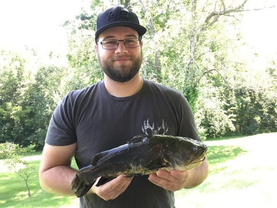 Cody Sparkman of Perryville holds his 2-pound, 13-ounce black bullhead caught on a jug line July 21 in Perry County.