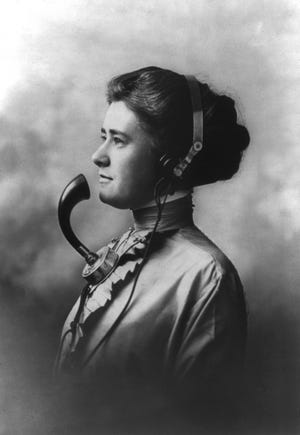 Telephone operator, c. 1905.