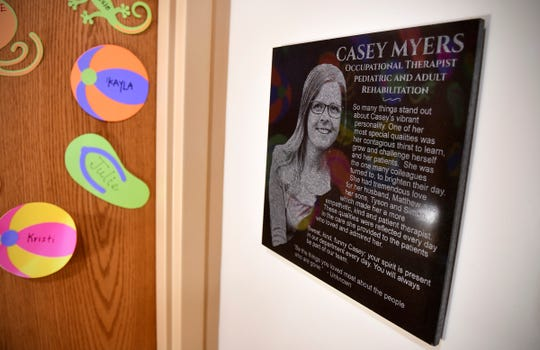 A memorial to Casey Myers is placed near the entrance to the pediatric rehab area Wednesday, July 31, 2019, at the CentraCare Plaza in St. Cloud.