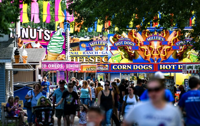People make their way down a main avenue Wednesday, July 31, 2019, at the Benton County Fair in Sauk Rapids.