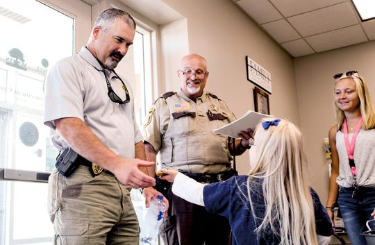 Sophina Lindquist, 10, of St. Cloud, visited Austin to give cookies to law enforcement, fire fighters and first responders Tuesday, July 30, 2019. Lindquist loves meeting police officers and firefighters, and wanted to thank them for their work.