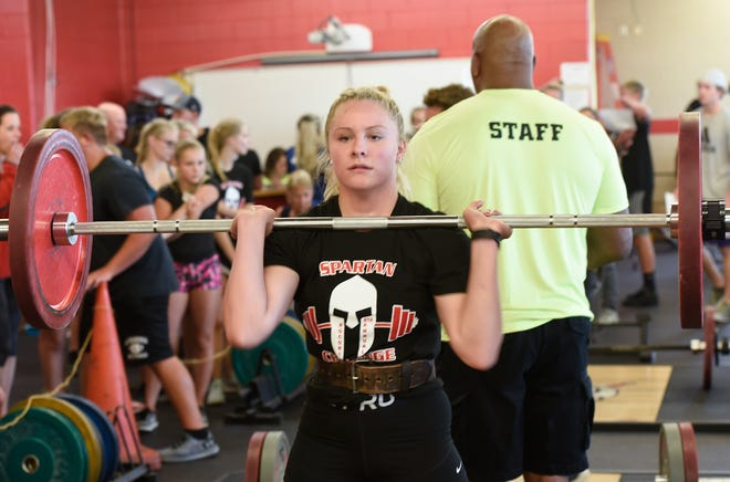ROCORI junior Grace Acheson practices her power cleans Wednesday, July 31, 2019, in the Spartan Challenge at ROCORI High School. Acheson set a girl's school record with a 180-pound power clean.