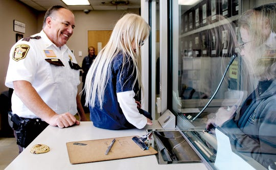 Mower County Sheriff Steve Sandvik spends time with guest Sophina Lindquist, 10, who traveled from St. Cloud to give cookies to law enforcement, firefighters and first responders as a token of thanks for their service on Tuesday, July 30, 2019.