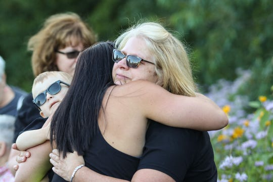 Casey Myers' mother, Pattie Gunderson, hugs Myers' former coworker Cassie Sandstrom on Monday, July 29, 2019, at CentraCare Health Plaza in St. Cloud. Myers, who worked in the pediatric and adult rehabilitation departments, died in a car crash in December.