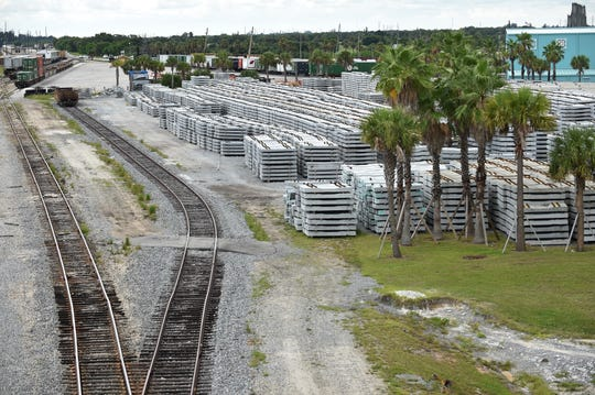 Hundreds of railroad ties are seen next to railroad tracks of the Florida East Coast rail yard on Wednesday, July 31, 2019, in Fort Pierce. Virgin Trains USA recently announced construction on Phase 2, service from West Palm Beach to Orlando International Airport, has begun.