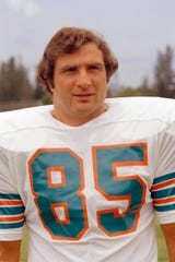 This 1973 file photo shows Miami Dolphins linebacker Nick Buoniconti. Buoniconti, an undersized overachiever who helped lead the Miami Dolphins to the NFL's only perfect season, has died at the age of 78.