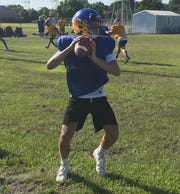 Martin County sophomore quarterback Jaxon Scott sets up to pass during Wednesday's practice.