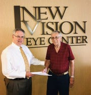 Dr. Paul Minotty, left, founder of New Vision Eye Center, with Charlie Pope, membership chair for Clean Water Coalition of Indian River County.