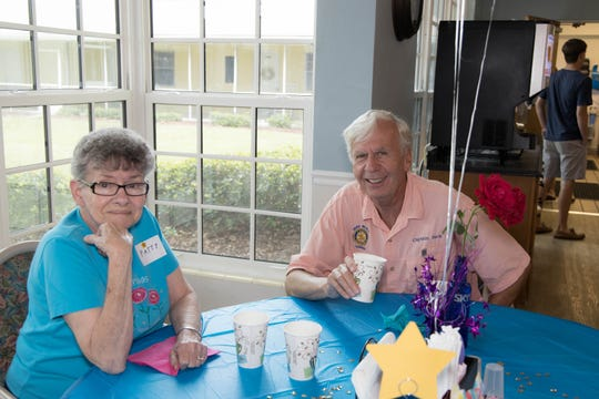 Rotarian Pastor Jack Diehl, right, talks to Patty at the Men's Day Barbecue on Father's Day at the Florida Baptist Retirement Center.