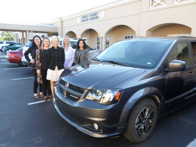 Whole Family Health staff Allison Zukowski, left, Carly Pye, Marie Andress, Sara Dingwall and Laura Graze with the 2019 seven-passenger Dodge Caravan bought with a $25,000 grant from the John's Island Foundation.