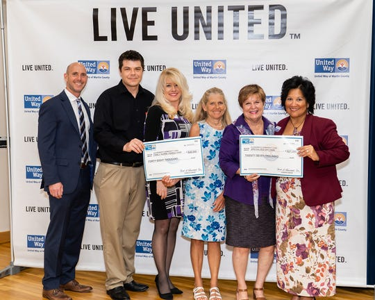 United Way of Martin County Board Chair Gene Zweben, left, and United Way CEO Carol G. Houwaart-Diez, right, present $75,000 in Community Impact Grant awards to Alzheimer's Community Care representatives Johnathan Price, Amy Bromhead, Dianne Bruce and Mary Barnes.