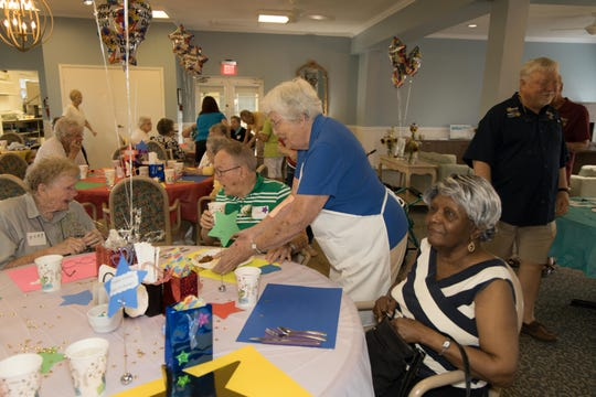 Rotarian Laddie Kruiten serves residents at the Men's Day Barbecue on Father's Day at the Florida Baptist Retirement Center.