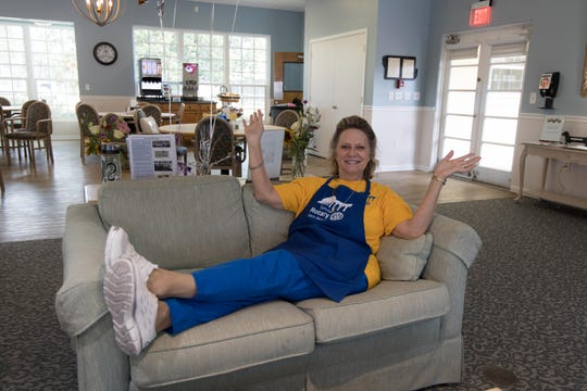 Rotarian Laura Kennedy kicks back after the Men's Day Barbecue on Father's Day was over at the Florida Baptist Retirement Center in Vero Beach. Kennedy was chair of the event.