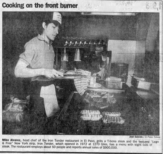 "Mike Alvarez, head chef of the Iron Tender restaurant, grills a T-bone steak and the featured ""Lean & Free"" New York strip in this Nov. 25, 1989, photo."