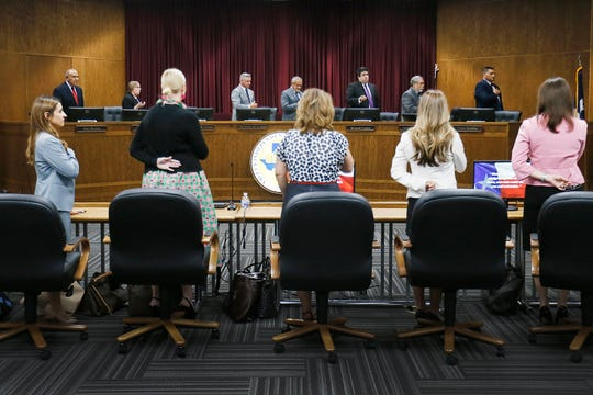 Attendees stand up for the Pledge of Allegiance before a special meeting of the Ysleta Independent School District board of trustees Tuesday, July 30, 2019, to discuss a superintendent personnel issue at YISD central administration building in El Paso.