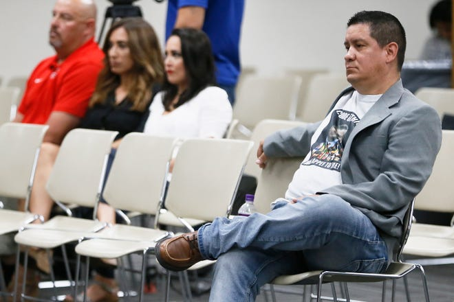 Daniel De La Cruz, parent of a YISD high school student, sits front and center for a special meeting of the Ysleta Independent School District board of trustees Tuesday, July 30, 2019, to discuss a superintendent personnel issue at the YISD central administration building in El Paso. De La Cruz spoke at a July 23 YISD board meeting.