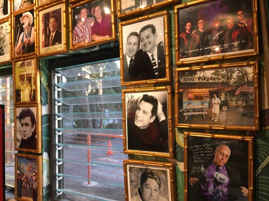 A mix of family photos and autographed celebrity headshots are seen inside Tony's Pizzaria in downtown Ventura. Seating is available outside.
