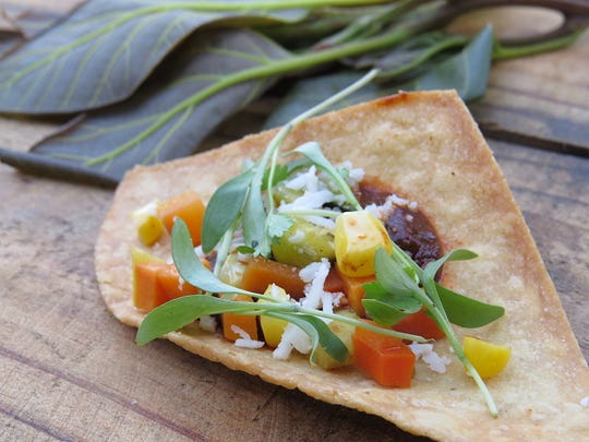 "Jacky Bui, executive chef at The 2686 Kitchen, used avocado leaves and ""at least five kinds of chilies"" to make the mole featured in her appetizer dish for the From Field to Fork dinner benefiting House Farm Workers!, a Santa Paula-based nonprofit. Now in its ninth year, the dinner netted more than $100,000."